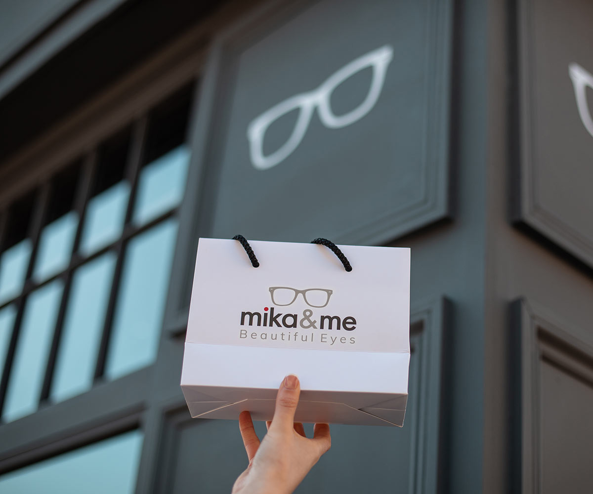 Mika-and-me-bag-infront-of-shop
